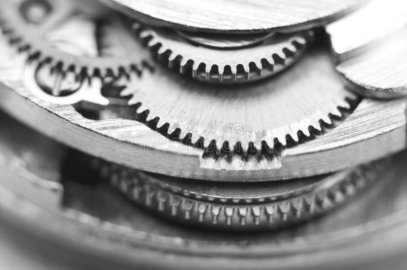 Black and white photography. Background with metal gear wheels. Macro. Black and white photography. Background with metal gear wheels. Conceptual photo for stock image