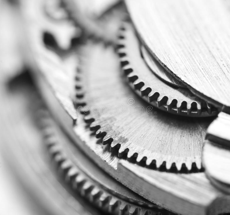 Black and white photography. Background with metal gear wheels. Macro. Black and white photography. Background with metal gear wheels. Conceptual photo for stock photo