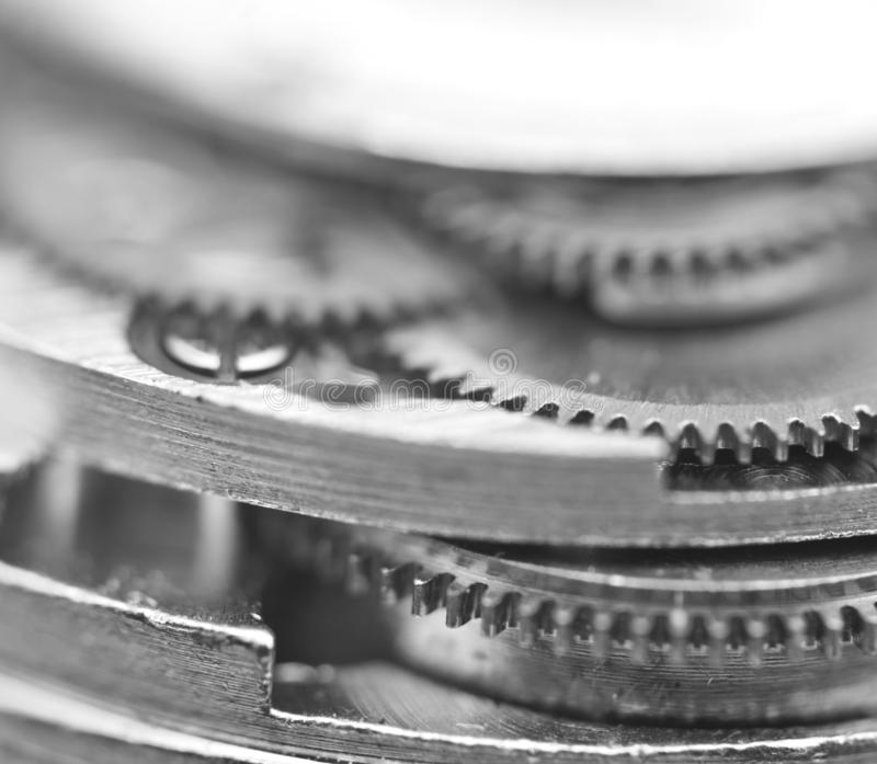 Black and white photography. Background with metal gear wheels. Macro. Black and white photography. Background with metal gear wheels. Conceptual photo for royalty free stock photography