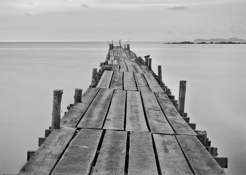 Black and white photography of a beach wooden pier royalty free stock photos