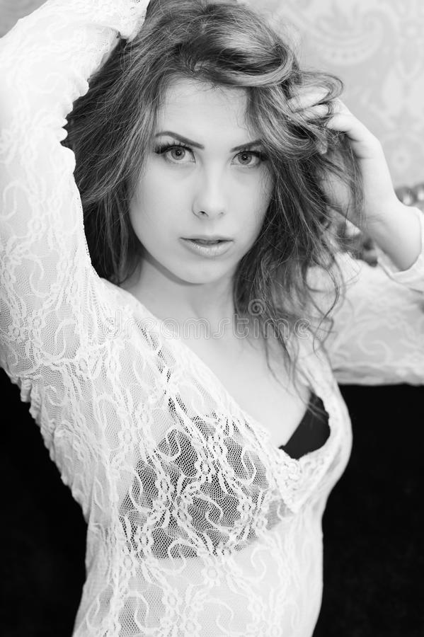 Black white photography of beautiful young woman relaxing looking at camera stock photo