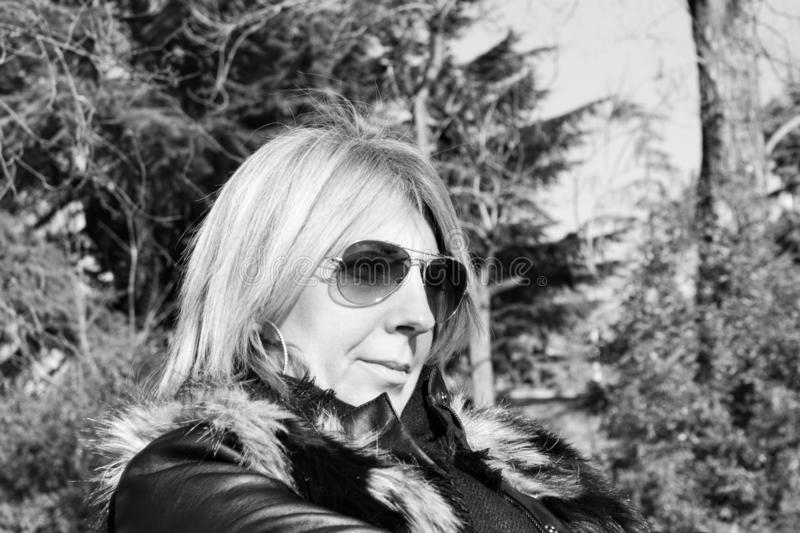 Black and white photography depicting a woman& x27;s face with sunglasses. Black and white photography depicting a woman& x27;s face with sunglasses royalty free stock photography