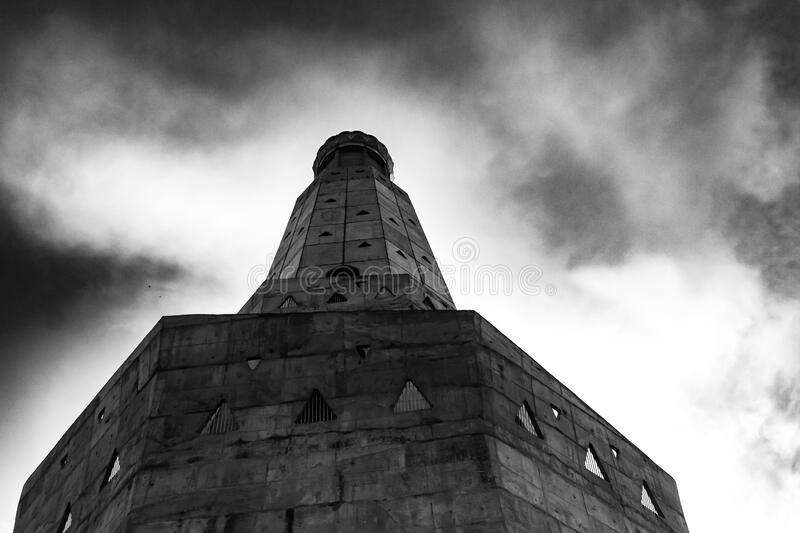 Black and white photography of historical building under cloudy sky. historical and vintage concept royalty free stock photo