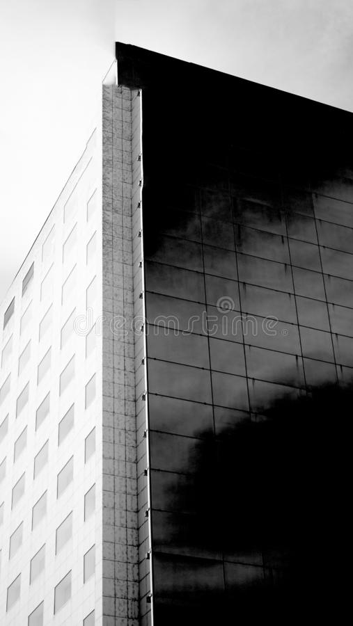 Modern glass building corner in black and white royalty free stock photography
