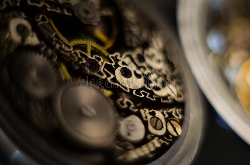 Black and white photography. Skeleton hours. Antique antique clockwork, jewelry engraving. mechanical pocket watch close-up. Selective focus royalty free stock photography