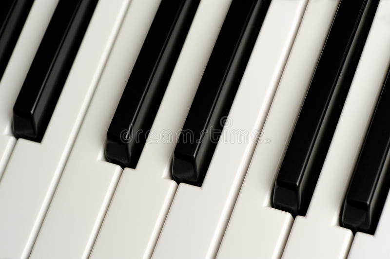 Black and White Piano Keys. A close-up of black and white piano keys stock photos