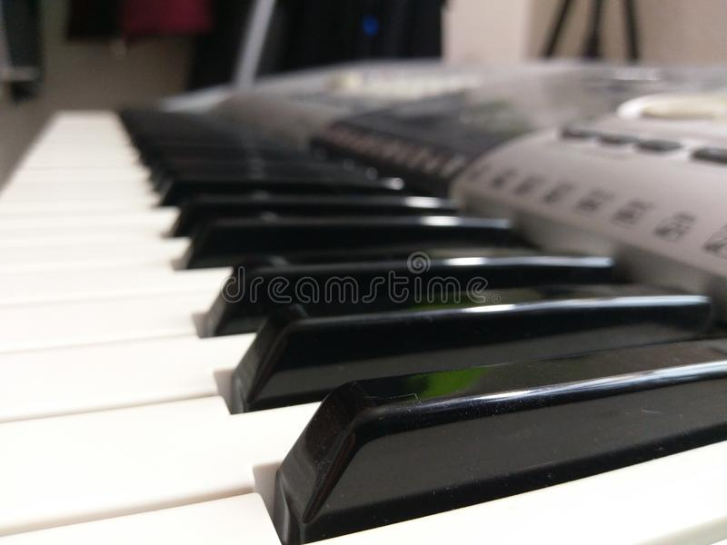 Black and white piano keys on a keyboard. Close-up of the black and white piano keys on a keyboard. This electric piano is a instrument with different functions stock photo