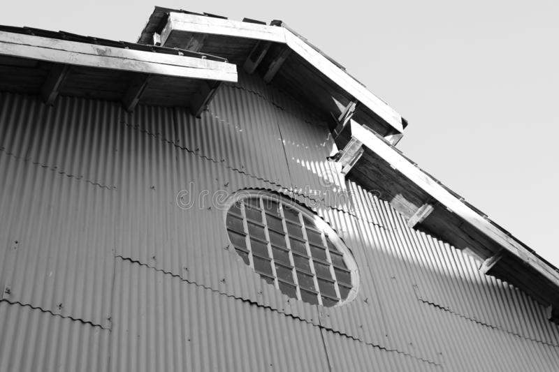 Black and white picture of Circle shape of sun ray house on the zinc wall and roof stock photography