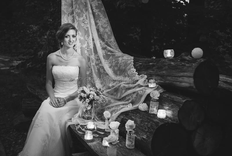 Black and white picture of a happy bride sitting stock photography