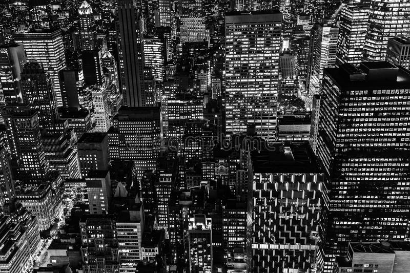 Black and white picture of Manhattan, NYC, at night. Black and white picture with an aerial view of Manhattan, NYC, at night stock images