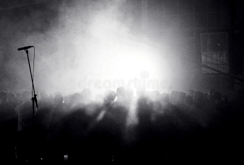 Croud of people at the concert. Black and white picture of people standing in the croud and waiting for the concert royalty free stock photos