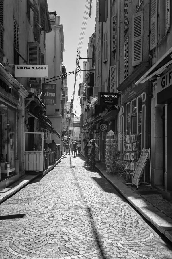 Black and white picture of the street Rue James Close in the old center of Antibes. Antibes, France, September 11, 2018: Black and white picture of the street royalty free stock image