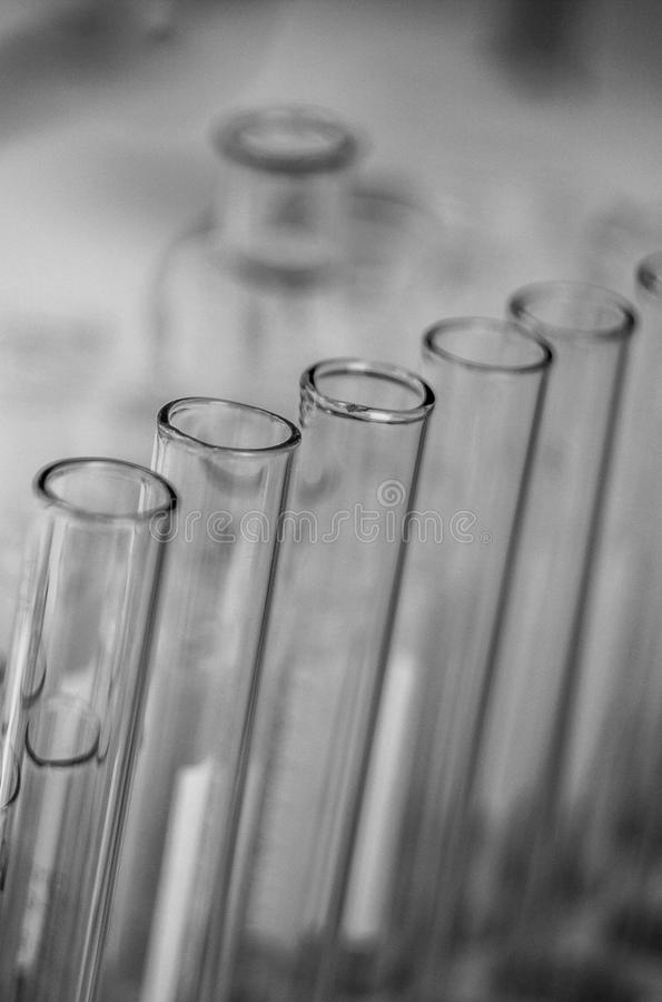 Black-and-white picture tubes, a series of tubes, glass container, laboratory glassware royalty free stock photo
