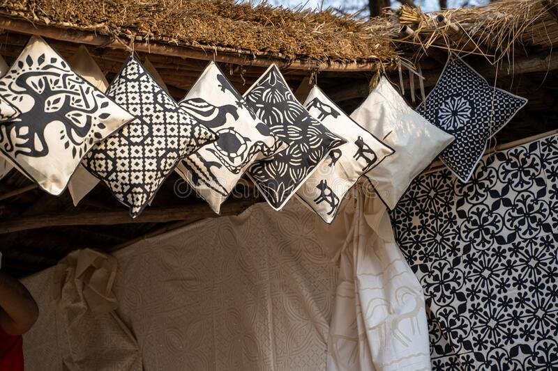 Black and white pillows for sale, hanging from a hut in Faridabad India, at the Surajkund Crafts Mela 2020.  royalty free stock photography