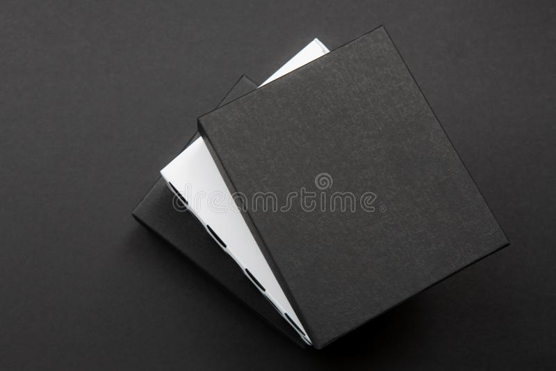 Black and white polka dot gift box on a dark contrasted background, creating a romantic atmosphere. Typically used for birthday, a. Nniversary presents, gift stock photos