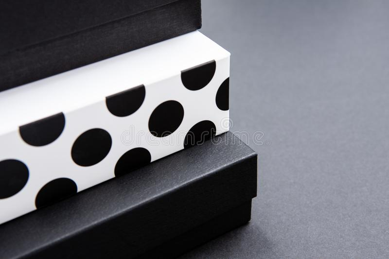 Black and white polka dot gift box on a dark contrasted background, creating a romantic atmosphere. Typically used for birthday, a. Nniversary presents, gift stock images