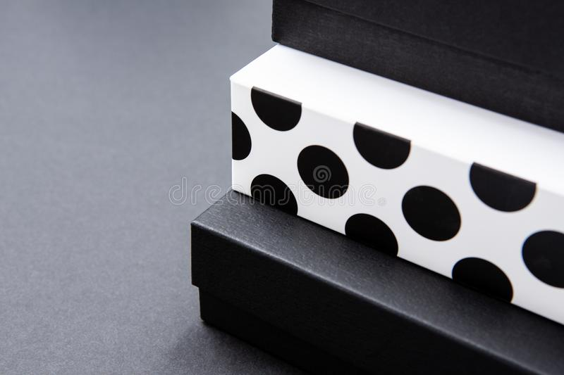 Black and white polka dot gift box on a dark contrasted background, creating a romantic atmosphere. Typically used for birthday, a. Nniversary presents, gift royalty free stock photos