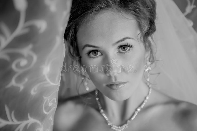 Black and white portrait of a Beautiful Bride Close up glowing from the sun light royalty free stock photography