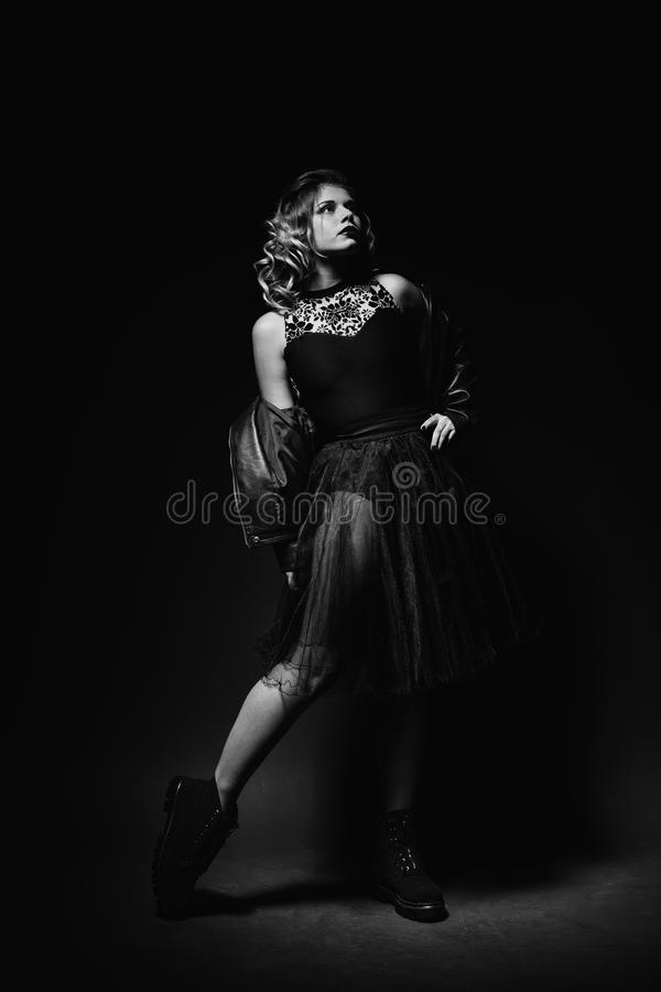 Black and white portrait of beautiful fit young ballerina girl royalty free stock photo