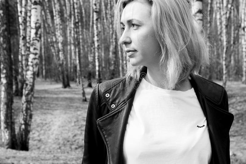 Black and white portrait of blonde young girl in the forest royalty free stock images