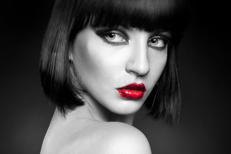 Black and white portrait of brunette in studio stock photo