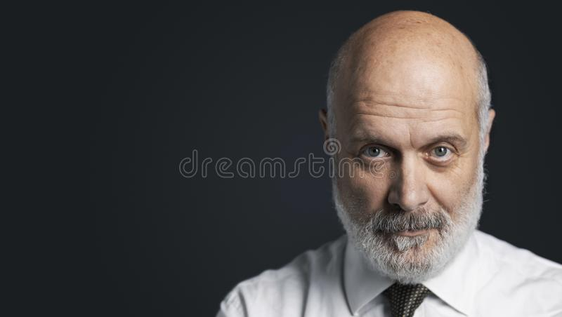Black and white portrait of a confident mature businessman royalty free stock photo