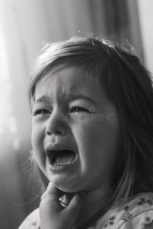 Black and white portrait of Cute little girl  is crying royalty free stock photo