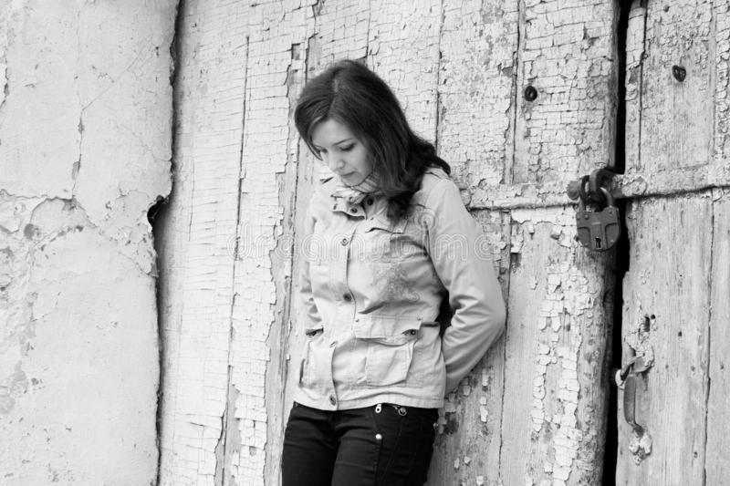 Portrait of a girl near the old door sadness depressed melancholy stock photos