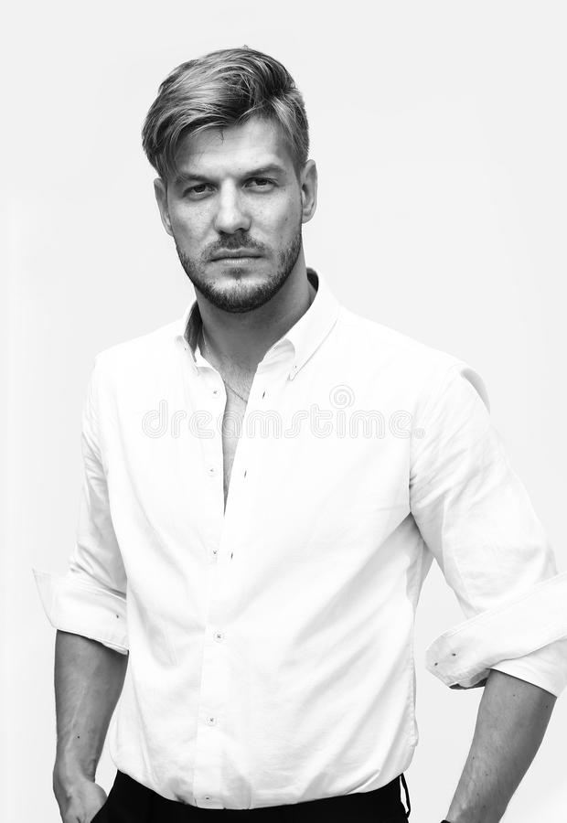 Black and white portrait of handsome man looking at camera stock image