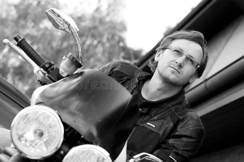 Black and white portrait of man on the bike stock photo