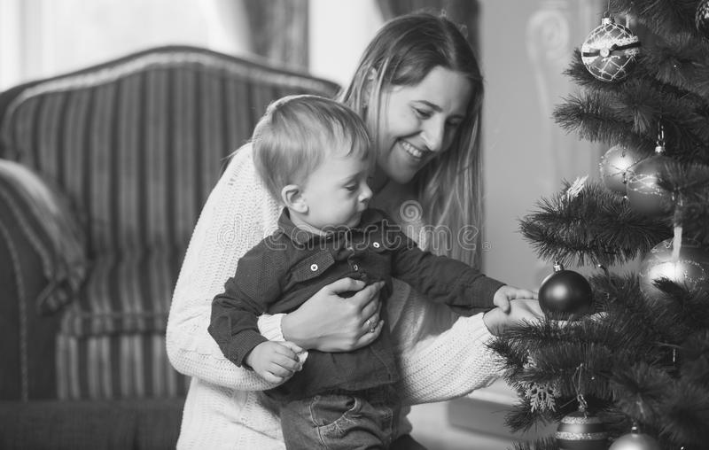 Black and white portrait of mother and baby boy decorating Chris royalty free stock image