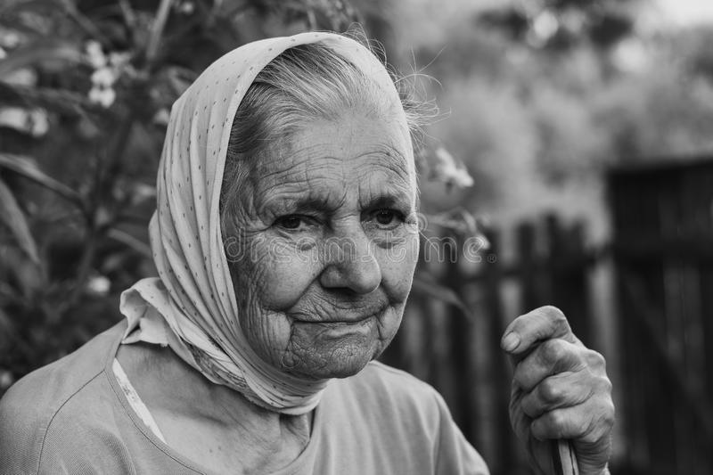 Black and white portrait of old lonly woman in headscarf. Elderly woman. stock images