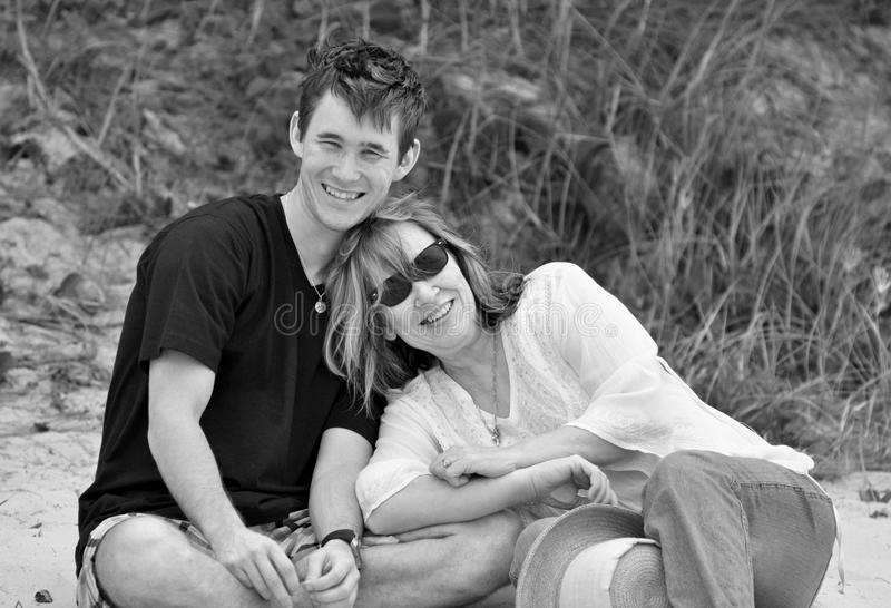 Black white portrait outdoors affectionate mother and teenage son stock photography