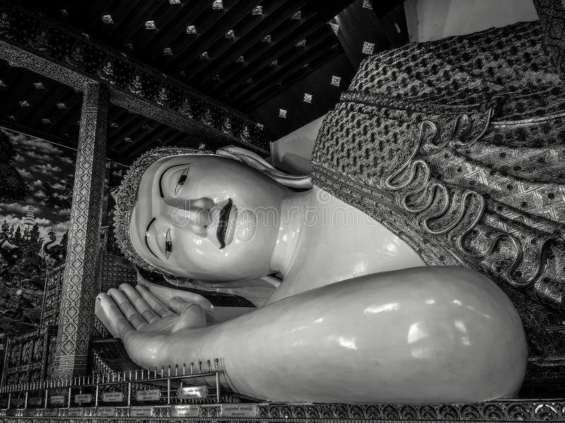 Black and white portrait of reclining Buddha at wat Banden in Thailand royalty free stock image