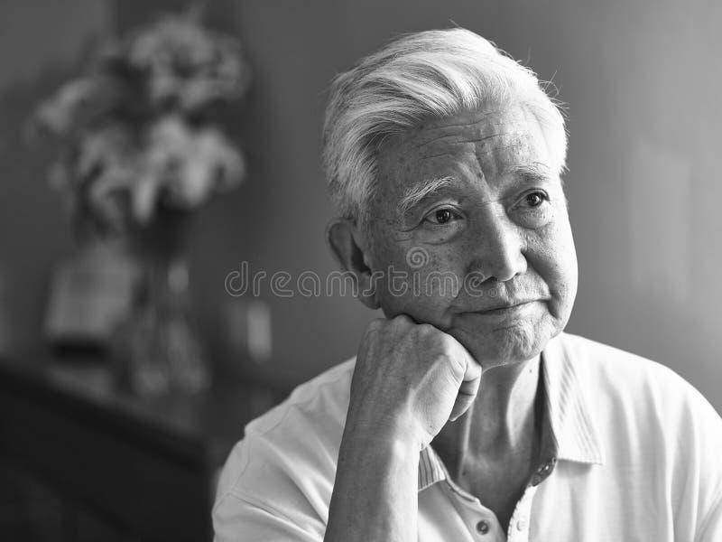Black and white portrait sad asian senior man stock photos