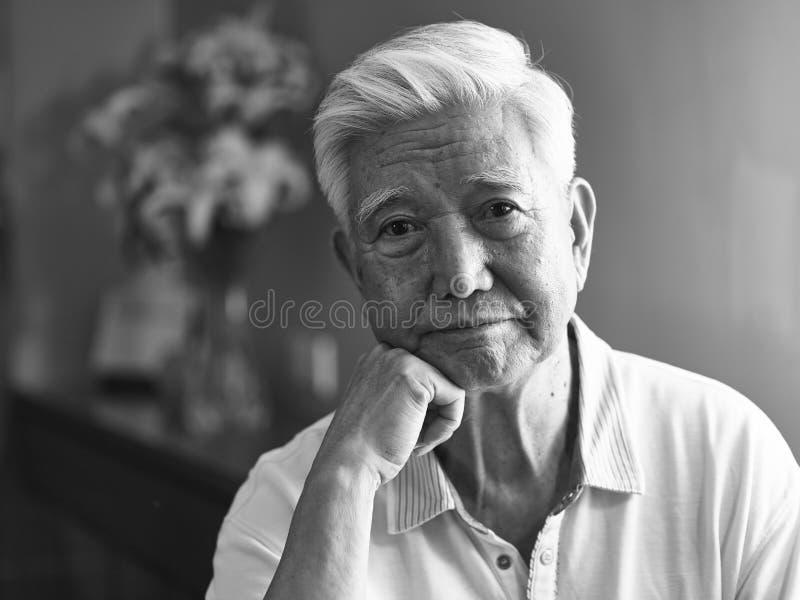 Black and white portrait sad asian senior man stock images