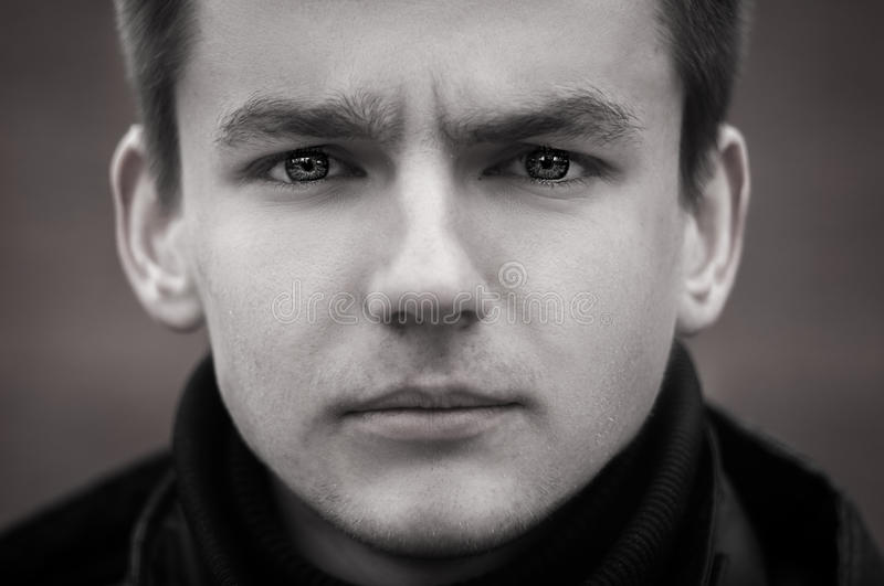 Black and white portrait of a sad guy royalty free stock photos