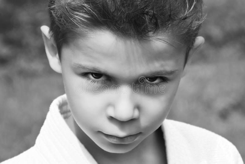 Black and white portrait of a serious boy in a kimono royalty free stock image