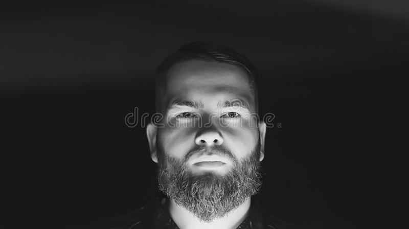 Black and white portrait of serious young man royalty free stock images