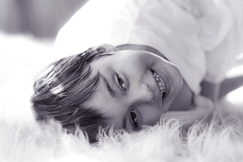 Black and white portrait of smiling boy royalty free stock photography