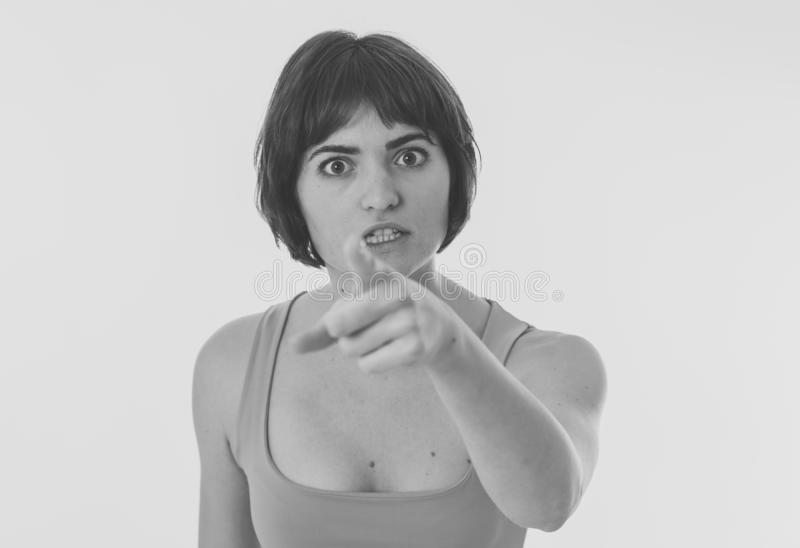 Portrait of a beautiful young woman with angry face looking furious. Human expressions and emotions. Black and white portrait of young attractive frustrated royalty free stock photography