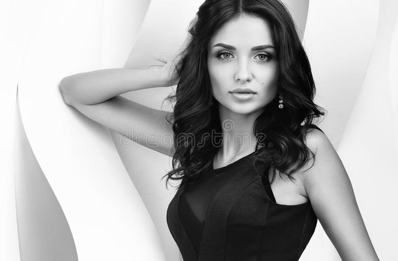 Black and white portrait of young beautiful woman have wavy walls royalty free stock image