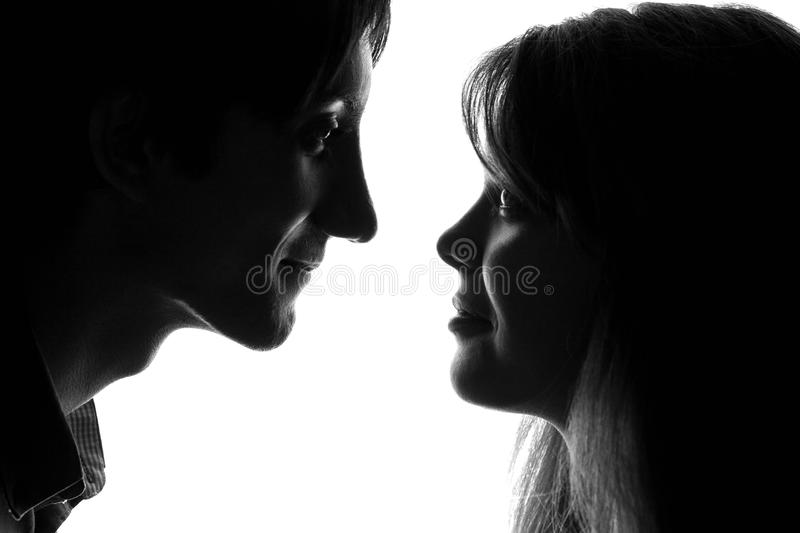 Black and white portrait of a young couple in love royalty free stock images