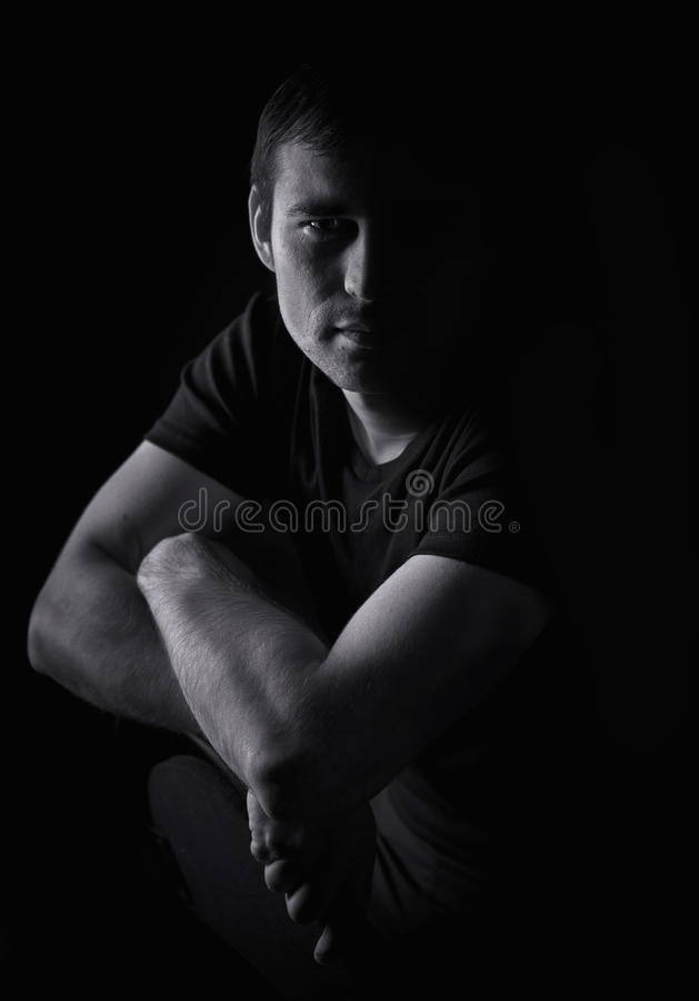 Black and white portrait of a young man stock images