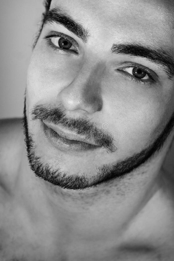 Black and white portrait of young and sensual italian man with beard stock images