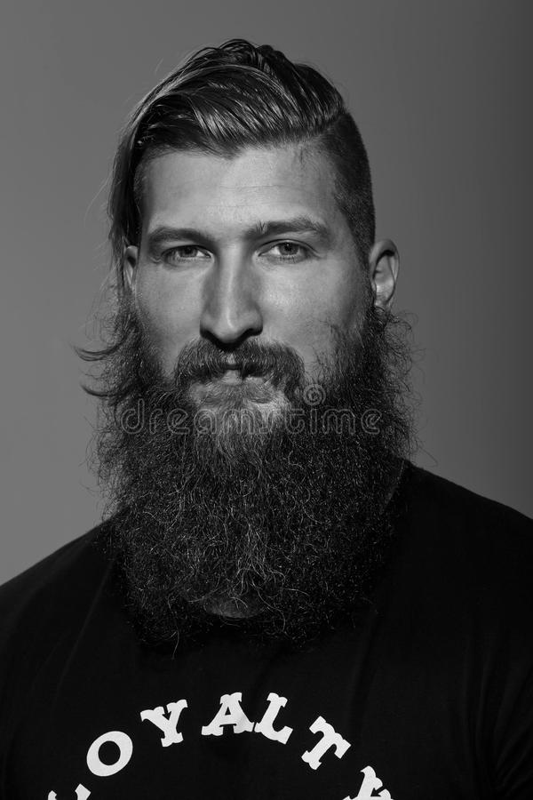 Black and white portrait of a young bearded man stock photos