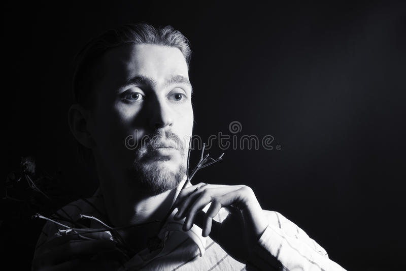 Black and white portrait of young trendy guy royalty free stock photos