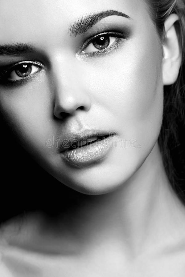 Black and white portrait of Young woman. Beauty black and white portrait of Young woman.Beautiful Girl face royalty free stock image