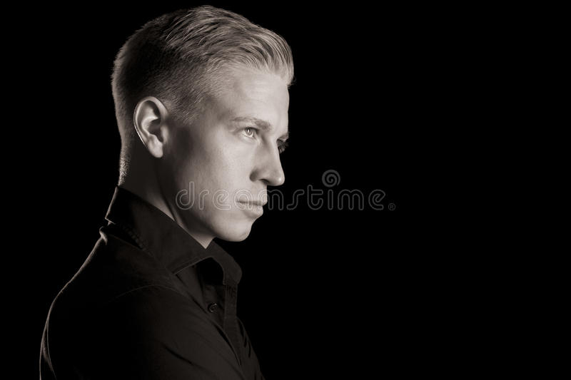 black and white profile portrait of attractive man low