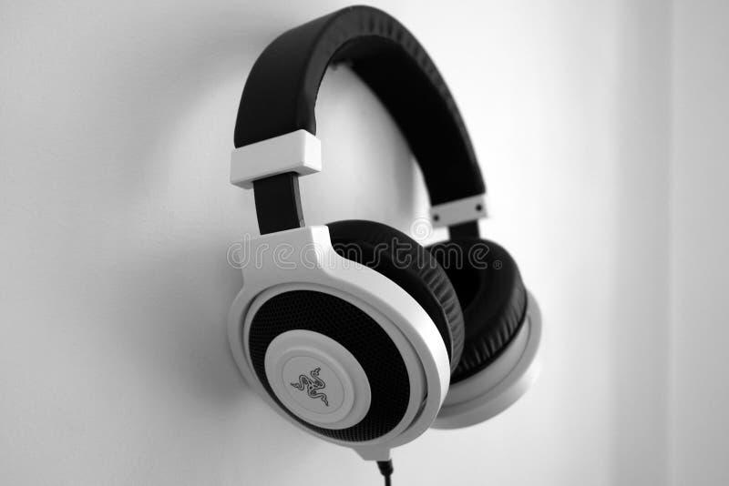 Black And White Razer Gaming Headset Hanging On White Painted Wall Free Public Domain Cc0 Image